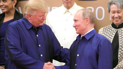 Putin and Trump shake hands at APEC meeting in Vietnam in November 2017